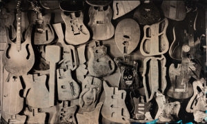 Hanging Tree guitars on wall, tintype