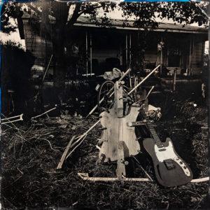 Clamping the hanging tree guitar, tintype