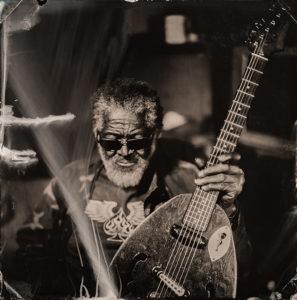 Freeman Vines with hanging tree guitar